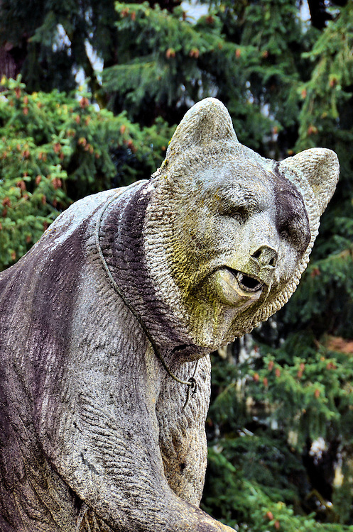 Bear Statue at Bernisches Historisches Museum in Bern, Switzerland <br /> You will see several statues of bears throughout Bern, Switzerland, like this one near the entrance of the Bernisches Historisches Museum.  The bear became the town&rsquo;s namesake in 1191 and has been their symbol since the 16th century.  Live bears used to reside in a pit called B&auml;rengraben until the B&auml;renPark or Bear Park was built for them along the River Aare in 2009.