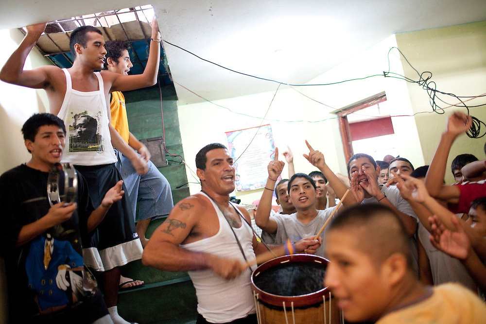 Paul De La Haca leads a drum circle at a religious program for former drug addicts on Sunday, Apr. 19, 2009 in Ventanilla, Peru.