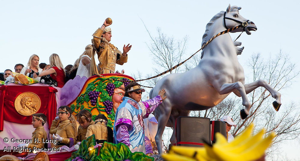 New Orleans Saints quarterback Drew Brees rides as King in Bacchus Mardi Gras parade