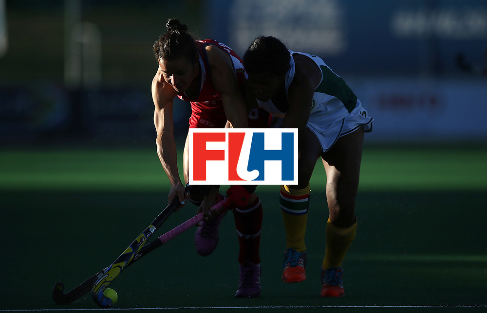 JOHANNESBURG, SOUTH AFRICA - JULY 16:  Caitlin van Sickle of United States of America battles with Suzette Damons of South Africa during day 5 of the FIH Hockey World League Women's Semi Finals Pool B match between South Africa and United States of America at Wits University on July 16, 2017 in Johannesburg, South Africa.  (Photo by Jan Kruger/Getty Images for FIH)