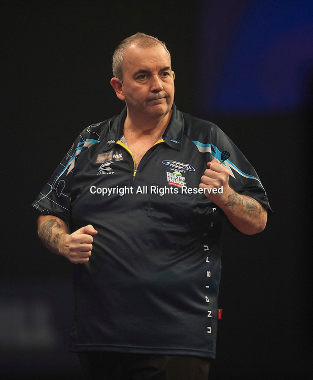 02.01.2014.  London, England.  William Hill PDC World Darts Championship.  Quarter Final Round.  Phil Taylor (2) [ENG] celebrates a winning leg in his match with Vincent van der Voort (23) [NED]