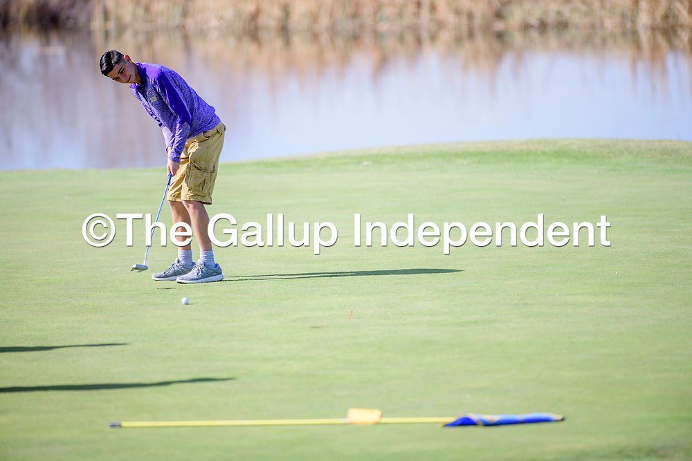 Kirtland Central Bronco Jenks makes a put attempt at the Grants Golf tournament  at the Coyote Del Malpais in Grants Tuesday.