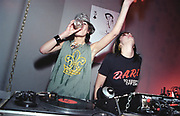 Two female DJ's, one drinking, UK 2000's