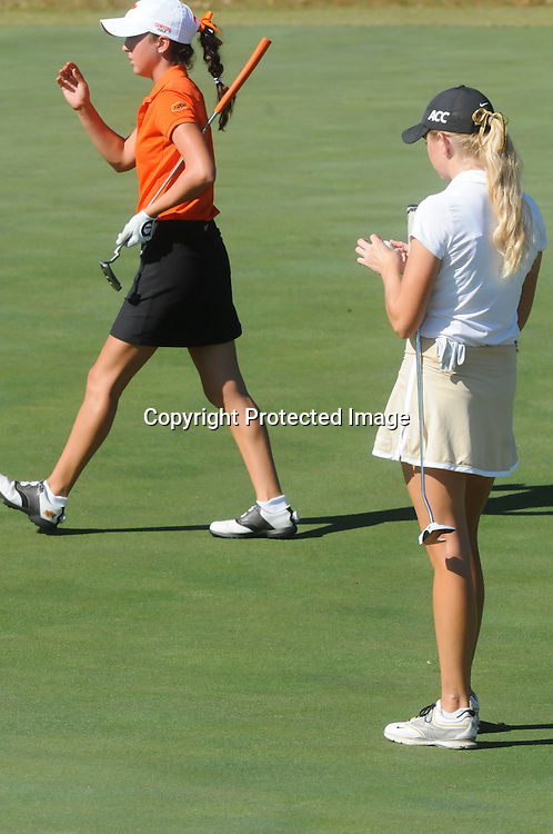 Oklahoma State's Alexis Sadeghy, left, and Wake Forest's Marissa Dodd prepare to putt Sunday October 26, 2014 during the 13th annual Landfall Tradition in Wilmington, N.C. (Jason A. Frizzelle)