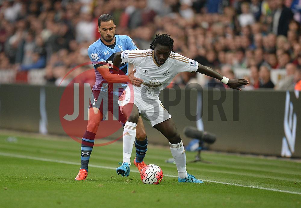 Bafetibis Gomis of Swansea City battles for the ball with Nacer Chadli of Tottenham Hotspur - Mandatory byline: Alex James/JMP - 07966 386802 - 04/10/2015 - FOOTBALL - Liberty stadium - Swansea, England - Swansea City  v Tottenham hotspur - Barclays Premier League