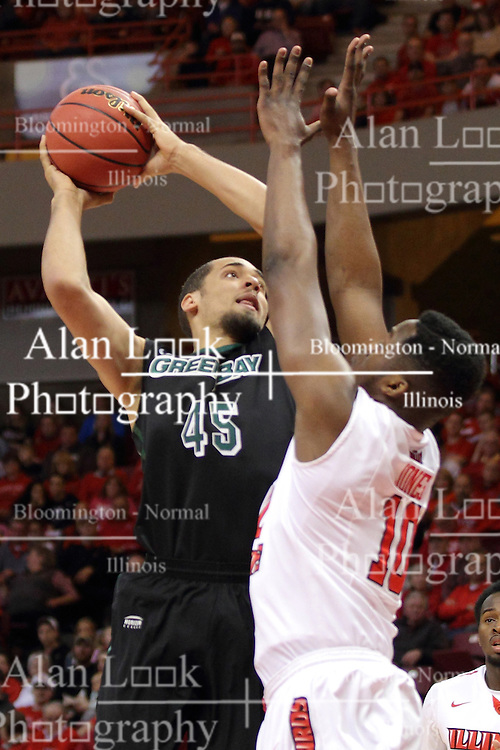 18 March 2015:   Kenneth Lowe lines up a shot over John Jones during an NIT men's basketball game between the Green Bay Phoenix and the Illinois State Redbirds at Redbird Arena in Normal Illinois