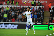 Dwight Tiendalli of Swansea city jumps for a header with Filipe Luis of Chelsea. Barclays Premier League match, Swansea city v Chelsea at the Liberty Stadium in Swansea, South Wales on Saturday 17th Jan 2015.<br /> pic by Andrew Orchard, Andrew Orchard sports photography.