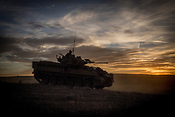 © Licensed to London News Pictures. 08/10/2014.  British Army Training Unit Suffield (BATUS), Canada. A warrior armoured vehicle returns to camp as a military exercise in Canada comes to an end.  <br /> <br /> BATUS has been home to the Army for the past 42 years .  It is the only place where all elements of the British Army train together for war.  The soldiers are put to test on everything from armoured vehicles to infantry tactics.        Photo credit : Alison Baskerville/LNP