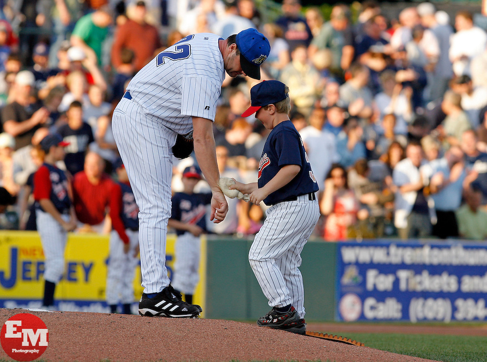 May 23, 2007; Trenton, NJ, USA;  Roger Clemens (22) gets rosen applied by a young boy before his start for the Trenton Thunder (New York Yankees Double-A affiliate) during their Eastern League game against the Portland Sea Dogs at Waterfront Park in Trenton, NJ.