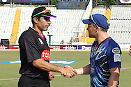 Faisalabad Wolves captain Misbah-Ul-Haq Kana and Otago Volts captain Brendon McCullum shake hands after the toss during the Qualifier 1 match of the Karbonn Smart Champions League T20 (CLT20) between Otago Volts and the Faisalabad Wolves held at the Punjab Cricket Association Stadium, Mohali on the 17th September 2013<br /> <br /> Photo by Shaun Roy/CLT20/SPORTZPICS<br /> <br /> <br /> Use of this image is subject to the terms and conditions as outlined by the CLT20. These terms can be found by following this link:<br /> <br /> http://sportzpics.photoshelter.com/image/I0000NmDchxxGVv4<br /> <br /> ENTER YOUR EMAIL ADDRESS TO DOWNLOAD