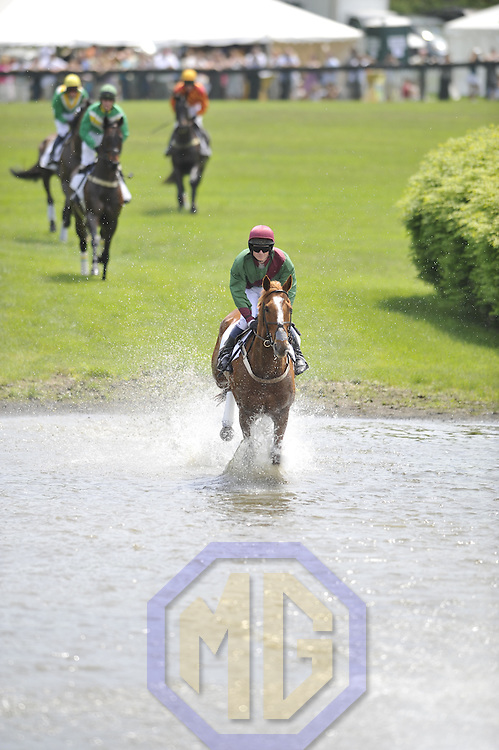 03 May 2008:  Jeff Murphy aboard Te Akau Five runs his horse through the water in the 2nd race of the 83rd running of the Virginia Gold Cup Races on October 20, 2007 at the Great Meadow in The Plains, Va..