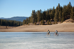"""Mountain Bikers on Prosser Reservoir"" - These mountain bikers were photographed riding on ice at a frozen Prosser Reservoir, Truckee."