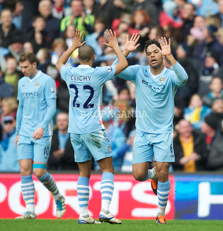 MANCHESTER, ENGLAND - Sunday, January 22, 2011: Manchester City's Joleon Lescott celebrates scoring the second goal against Tottenham Hotspur during the Premiership match at the City of Manchester Stadium. (Pic by David Rawcliffe/Propaganda)