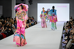 © Licensed to London News Pictures. 04/06/2018. London, UK.  A model presents a look by Charlotte Moore from Birmingham University on day two of Graduate Fashion Week taking place at the Old Truman Brewery in East London. The event presents the graduation show of up and coming fashion designers from UK and international universities.  Photo credit: Stephen Chung/LNP