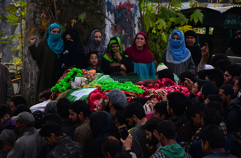 November 10, 2018 - A large crowd wail during the funeral procession of alleged militant Wajid ul Islam in the Pulwama district of Indian Administered Kashmir on 10 November 2018. According to the police, Wajid ul Islam is one of  the two Hizb ul Mujahideen rebels killed in a gunfight with the government forces in the Tikken area of south Kashmir's Pulwama district in the morning of Saturday 10th November. A complete shutdown was observed in south Kashmir's Pulwama district on Saturday to mourn the killings of the two Hizb ul Mujahideen militants, Liyaqat Wani and Wajid ul Islam (Credit Image: © Muzamil Mattoo/IMAGESLIVE via ZUMA Wire)