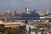Cruise ship with the skyline of San Juan in San Juan, Puerto Rico.