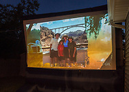 "Merrick, New York, USA. 11th June 2017.  Family vacation photo shown on large screen is of ""American Grit"" TV show contestant CHRIS EDOM, now 48 of Merrick, during Season 2 premiere of the reality show. Edom family's relatives and neighbors watched Episode 1 of the Fox network TV show on large screen in their backyard."