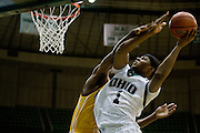 Ohio's DeVaughn Washington meets some resistance while taking the basketball to the hoop Tuesday hile playing Central Michigan at the convo. photo by Kevin Riddell