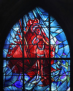The resurrected Christ rising from the tomb, stained glass window, 1974, by Marc Chagall, 1887-1985, with the studio of Jacques Simon, in the axial chapel of the apse of the Cathedrale Notre-Dame de Reims or Reims Cathedral, Reims, Champagne-Ardenne, France. The cathedral was built 1211-75 in French Gothic style with work continuing into the 14th century, and was listed as a UNESCO World Heritage Site in 1991. Picture by Manuel Cohen