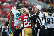 San Francisco 49ers running back Matt Breida (22) and Jacksonville Jaguars defensive end Yannick Ngakoue (91) exchange some words at Levi's Stadium in Santa Clara, Calif., on December 24, 2017. (Stan Olszewski/Special to S.F. Examiner)