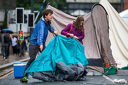 © Licensed to London News Pictures. 19/07/2019. Leeds UK. Extinction Rebellion activist's have started to leave Victoria Bridge in Leeds this morning on the fifth day of the protest. Activist's had blocked Victoria Bridge in the city centre with a boat & tents. The protest is part of Extinction Rebellion's 'summer uprising' campaign, which has seen similar blockades in London, Cardiff, Bristol and Glasgow & is expected to last until Friday.Photo credit: Andrew McCaren/LNP