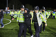 Police arrest fan after pitch invasion during the The FA Cup match between Sutton United and Arsenal at Gander Green Lane, Sutton, United Kingdom on 20 February 2017. Photo by Phil Duncan.