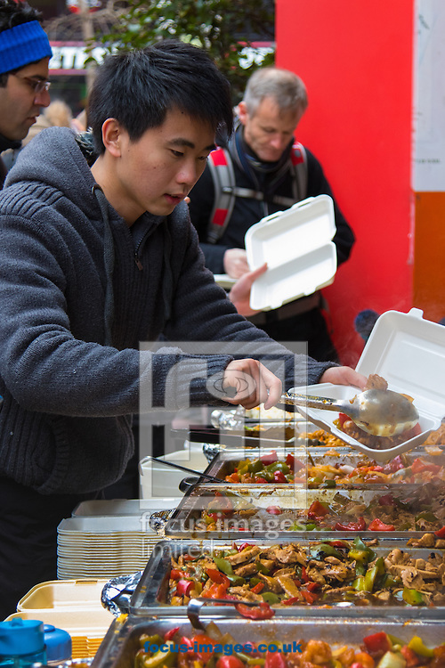Chinese street food traders do a brisk trade as Thousands of Londoners help the capital&rsquo;s Chinese population celebrate their new year, The Year of The Monkey in Chinatown, London.<br /> Picture by Paul Davey/Focus Images Ltd +447966 016296<br /> 14/02/2016