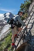 A metal ladder assists hikers on the Spires Trail which ascends steeply to Conrad Kain Hut (6 miles round trip with 2400 ft gain), in Bugaboo Provincial Park, in the Purcell Range of the Columbia Mountains, British Columbia, Canada. Bugaboo Glacier. To license this Copyright photo, please inquire at PhotoSeek.com.