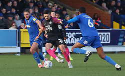 Niall Mason of Peterborough United in action with Nesta Guinness-Walker and Terell Thomas of AFC Wimbledon - Mandatory by-line: Joe Dent/JMP - 18/01/2020 - FOOTBALL - Cherry Red Records Stadium - Kingston upon Thames, England - AFC Wimbledon v Peterborough United - Sky Bet League One