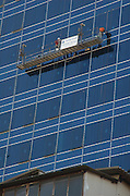 Israel Tel Aviv A new high rise building going up in down town Tel Aviv Hertzl street, September 2005, scaffolds with workers installing windows can be seen on the building face