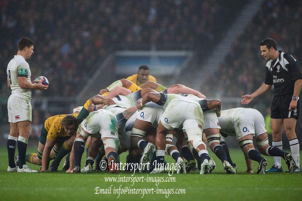 "Twickenham, Surrey. UK. Right, Referee, Ben O'KEEFFE, watches the England scrum as Ben YOUNGS, waited for the ""Put In Signal""  from the ref.  <br /> England VS Australia, Autumn International. Old Mutual Wealth Series. RFU Stadium, Twickenham. UKduring the <br /> England VS Australia, Autumn International. Old Mutual Wealth Series. RFU Stadium, Twickenham. UK<br /> <br /> Saturday  18.11.17<br /> <br /> [Mandatory Credit Peter SPURRIER/Intersport Images]"