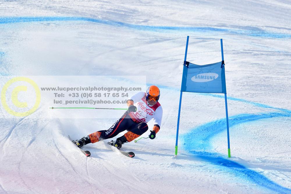 Forerunner competing in ParaSkiAlpin, Para Alpine Skiing, Super G at PyeongChang2018 Winter Paralympic Games, South Korea.