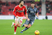 Middlesbrough midfielder Jonny Howson (16) looks for support as he is pressured by Millwall defender Ben Marshall (44) during the EFL Sky Bet Championship match between Middlesbrough and Millwall at the Riverside Stadium, Middlesbrough, England on 19 January 2019.