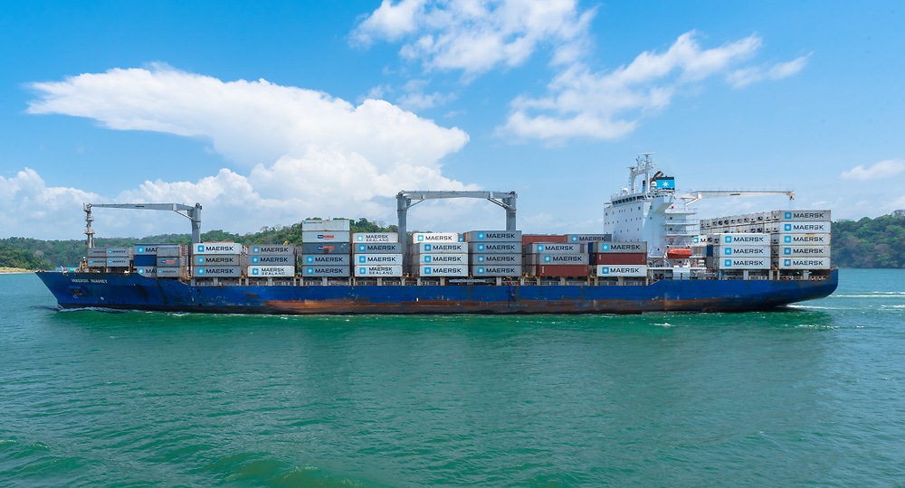 Panama Canal, Panama--April 18, 2018. A large container ship makes its way down the Panama Canal. Editorial use only.