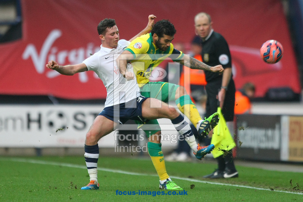 Alan Browne of Preston and Bradley Johnson of Norwich in action during the FA Cup match at Deepdale, Preston<br /> Picture by Paul Chesterton/Focus Images Ltd +44 7904 640267<br /> 03/01/2015