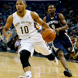 Dec 13, 2013; New Orleans, LA, USA; New Orleans Pelicans shooting guard Eric Gordon (10) drives past Memphis Grizzlies shooting guard Tony Allen (9) during the first quarter of a game at New Orleans Arena. Mandatory Credit: Derick E. Hingle-USA TODAY Sports
