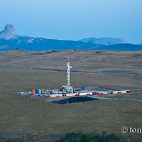 oil drilling rig drilling on blackfeet reservation glacier national park background conservation photography - blackfeet oil