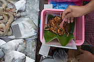 fish seller's breakfast. Char kueh kok 9fried radish cake). Chow Rasta market, George Town, Penang, Malaysia