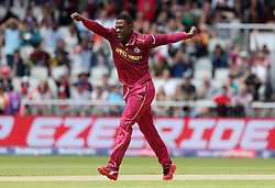 West Indies Sheldon Cottrell celebrates taking the wicket of New Zealand's Colin Munro during the ICC Cricket World Cup group stage match at Old Trafford, Manchester.