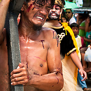 PHILIPPINES (Boac, Marinduque Island). 2009. Way of the Cross procession at Moriones Festival in Boac. Moriones is a religious festival held every year at Easter  in Marinduque Island which links the story of Longinus with Christs Passion and Death.