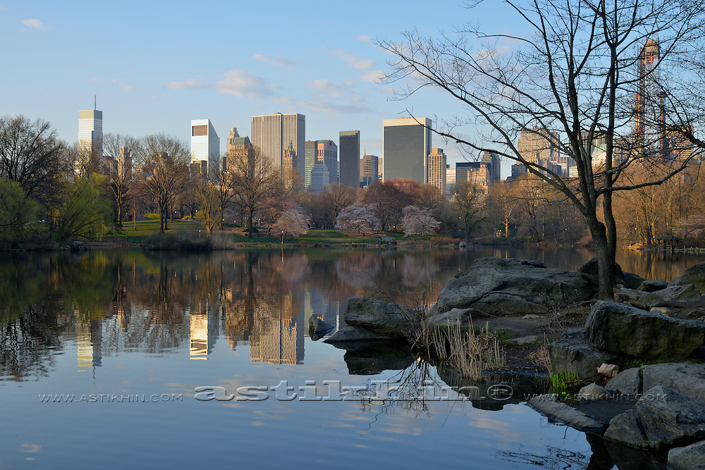 Reflection of New York City in water of Central Park.