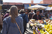 Tourists enjoy a food tour of Marrakech with Marrakech Food Tours, Marrakesh, Morocco, 2016–04-16.<br /><br />The tour included tasting and learning about tangia Marrakechia, mechoui, meloui, hachar, cous cous, escargot, Moroccan bread, street food dessert snacks, sardine kefta, steamed goats head and the classic Moroccan mint tea.