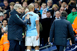 Manuel Pellegrini looks disappointed as Captain Vincent Kompany leaves the pitch with a calf injury  - Mandatory byline: Matt McNulty/JMP - 15/03/2016 - FOOTBALL - Etihad Stadium - Manchester, England - Manchester City v Dynamo Kyiv - Champions League - Round of 16