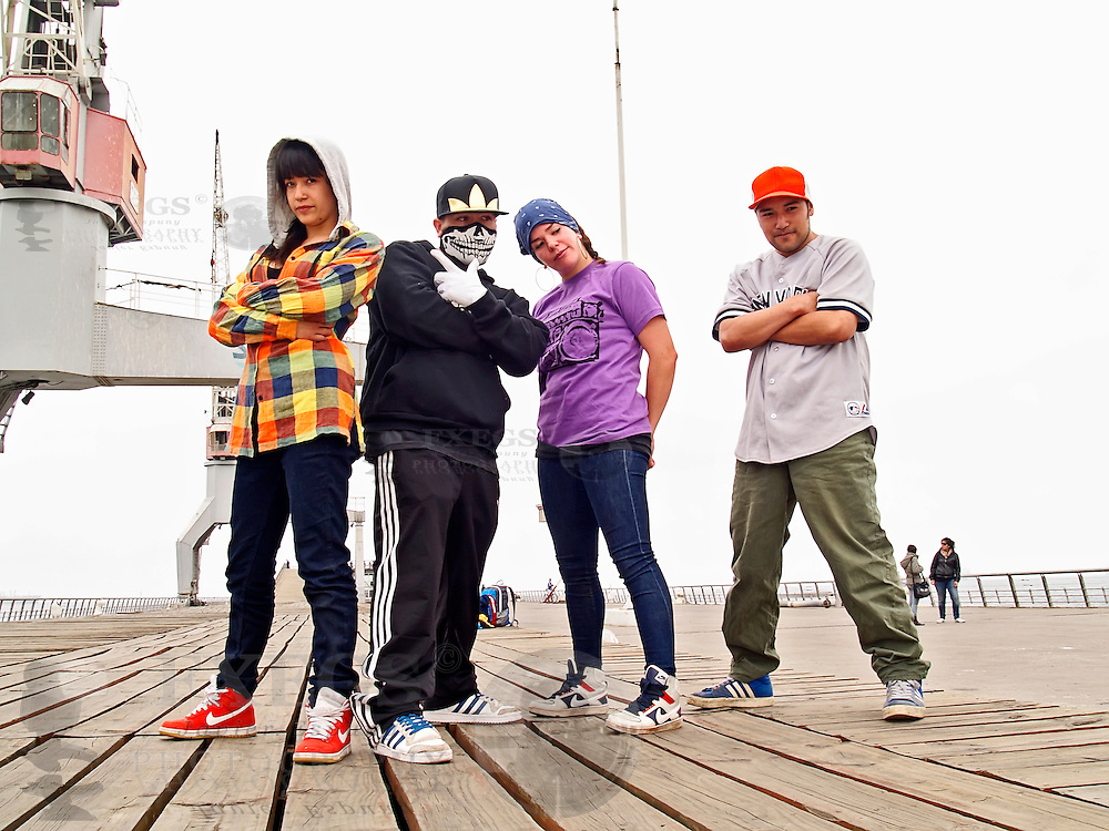 Group of rappers posing at the city of Valparaiso, Chile