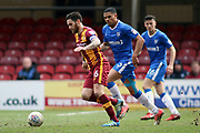 Bradford City midfielder Romain Vincelot (6) in possession and being closed down by Gillingham defender Bradley Garmston (3) during the EFL Sky Bet League 1 match between Bradford City and Gillingham at the Northern Commercials Stadium, Bradford, England on 24 March 2018. Picture by Mick Atkins.