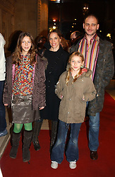 Artist DINOS CHAPMAN and his wife and their daughters Left, SERAPHINE and right AGATHE at the return of Dralion to celebrate the Cirque Du Soleil's 20th Anniversary at the Royal Albert Hall, London on 6th January 2005.<br /><br />NON EXCLUSIVE - WORLD RIGHTS