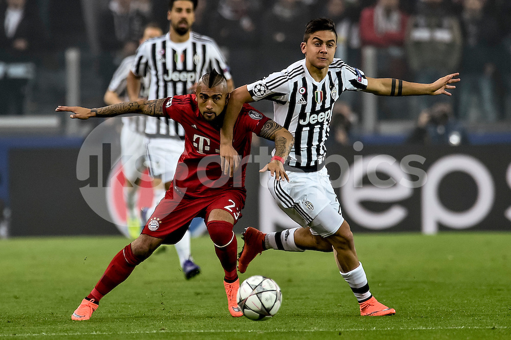 Arturo Vidal of Bayern Munchen challenges Paulo Dybala of Juventus  during the UEFA Champions League match Round of 16 between Juventus and Bayern Munich at the Juventus Stadium, Turin, Italy on 23 February 2016. Photo by Giuseppe Maffia.