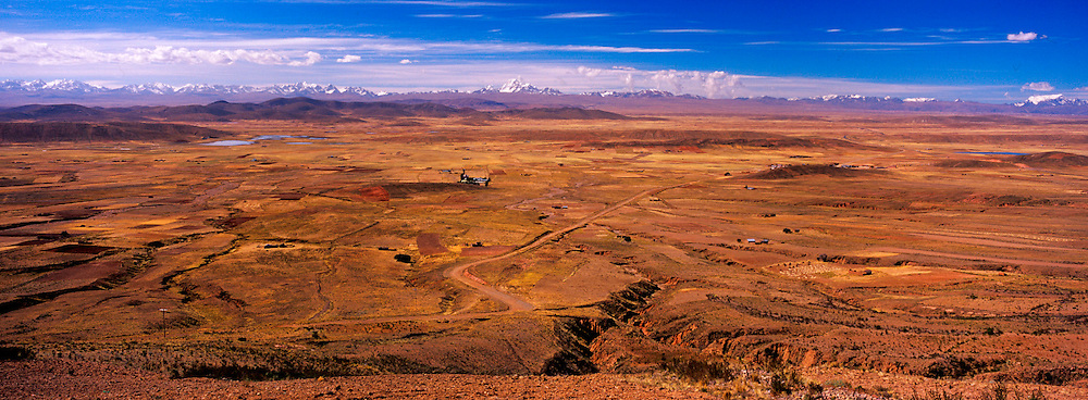 BOLIVIA, ALTIPLANO, ANDES view across the 14,000 foot high altiplano toward the peaks in the Cordillera Real  Range south of La Paz city