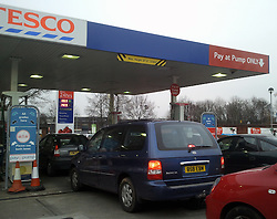 © Licensed to London News Pictures. 04/02/2012. Queues for petrol at a Tesco supermarket in Edgington Way, Sidcup. Bad weather and heavy snowfall are forecast for much of the UK over the next 24hrs. Photo credit : Grant Falvey/LNP