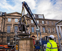 The sculpture of Sherlock Holmes by former pop-artist Gerald Laing is being moved from it's home on Picardy Place, yards from the birth place of Sir Arthur Conan Doyle.<br /> <br /> The move of the sculpture is to accommodate road and tram works that are taking place in Edinburgh. The statue will be moved to Nairn at  Black Isle Bronze Ltd by the artists son, Farquhar Laing where it will stay for two years until it returns to Edinburgh.<br /> <br /> Pictured: The statue lifted into the air as it is moved onto the truck that will take it back to Nairn